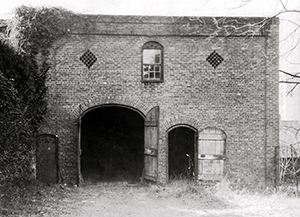 Photo of the Burgwin-Wright carriage house taken in 1938
